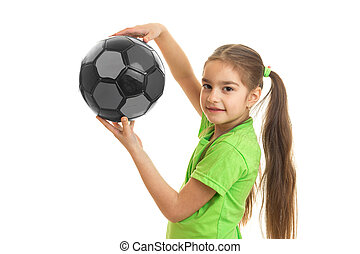 Portrait of a beautiful little girl with the ball in the hands of a close-up