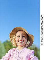 Portrait of a beautiful little summer child