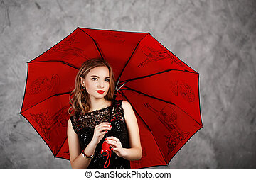 Young woman with red umbrella