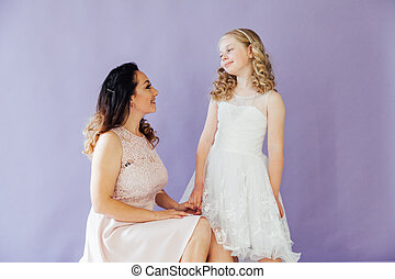 Portrait of a beautiful mother with daughter love family