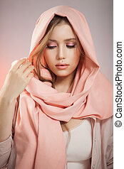 Portrait of a beautiful mysterious woman wearing a headscarf.