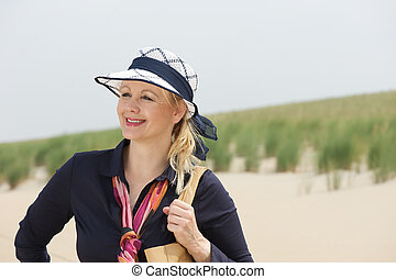 Portrait of a beautiful older woman smiling at the beach