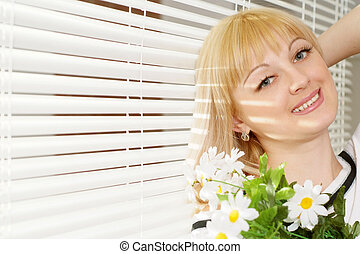Portrait of a beautiful pretty Caucasian woman with flowers