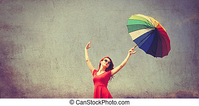 girl in red dress with umbrella