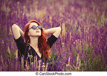 girl with sunglasses on lavender field.