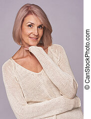 beautiful senior woman isolated on grey