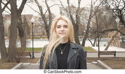Portrait of a beautiful sexy girl with blond hair, happy smiling.