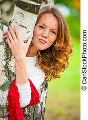 portrait of a beautiful slim girl near the birch