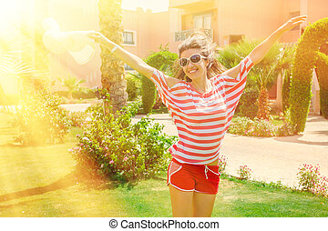 portrait of a beautiful smiling girl in sunglasses