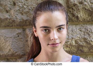 portrait of a beautiful smiling teenage girl