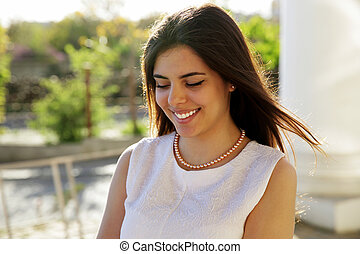 Portrait of a beautiful smiling woman outdoors