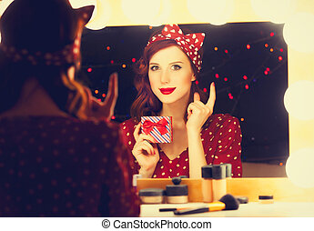 smiling woman with present box