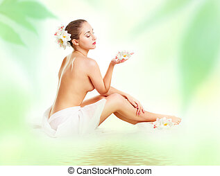 portrait of a beautiful spa girl with flowers