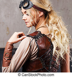Portrait of a beautiful steampunk woman in Aviator glasses...
