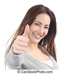 Portrait of a beautiful teen with thumb up gesture on a...