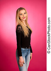 Portrait of a beautiful teenage girl over pink background