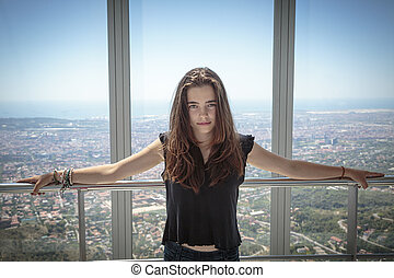 portrait of a beautiful teenager girl with aerial view on barcel