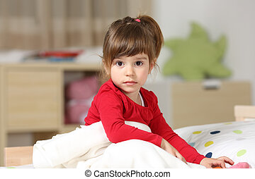 Portrait of a beautiful toddler girl in her room