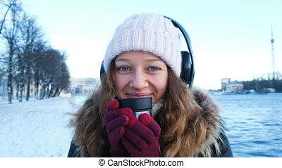 Portrait of a beautiful winter girl in hat