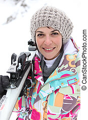 Portrait of a beautiful woman at ski resort