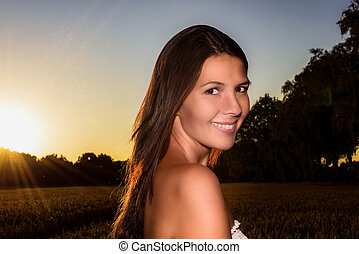 Portrait of a beautiful woman at sunset