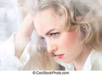 Portrait of a beautiful woman close-up window