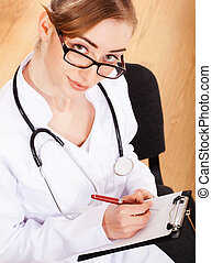 Portrait of a beautiful woman doctor with a stethoscope.