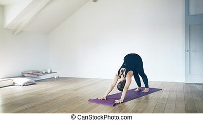Portrait of a beautiful woman doing yoga indoors