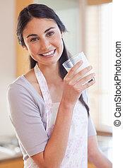 Portrait of a beautiful woman drinking milk