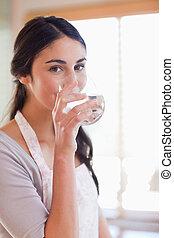 Portrait of a beautiful woman drinking water