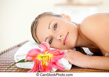 Portrait of a beautiful woman having a massage in a spa