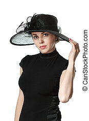 Portrait of a beautiful woman in a black dress and hat isolated on white background