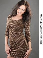 beautiful woman in a brown dress