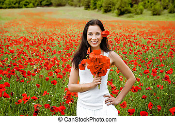 portrait of a beautiful woman in a field with flowers