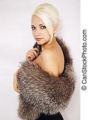 woman in a fur cape