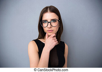 Portrait of a beautiful woman in glasses
