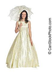 Portrait of a beautiful woman in golden dress