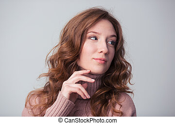 Portrait of a beautiful woman looking away