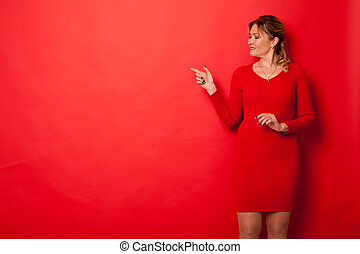 Portrait of a beautiful woman of forty years shows the side of the hand