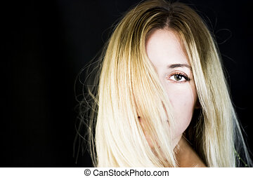 Portrait of a beautiful woman on black background