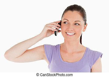 Portrait of a beautiful woman on the phone while standing