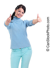 Portrait of  a beautiful woman showing thumbs up over white
