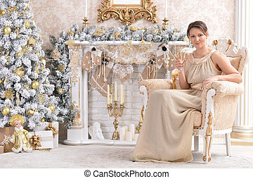 Portrait of a beautiful woman sitting in chair
