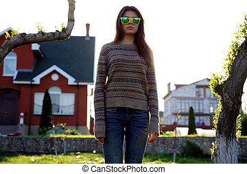 Portrait of a beautiful woman standing in garden