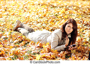 portrait of a beautiful woman using mobile phone