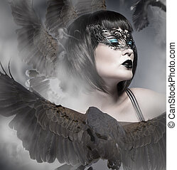 Portrait of a beautiful woman wearing a venetian mask with big eagle