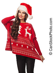 Portrait of a beautiful woman wearing a santa hat smiling, warm sweater, isolated on white background
