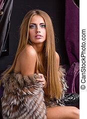 beautiful woman wearing fur