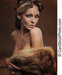 portrait of a beautiful woman wearing fur