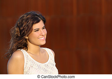 Portrait of a beautiful woman with a corten steel background
